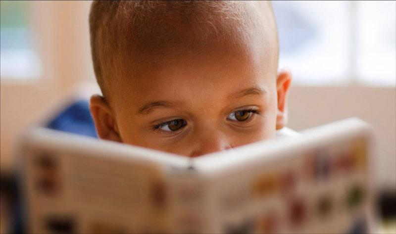 boy-reading-eyes-over-book.jpg