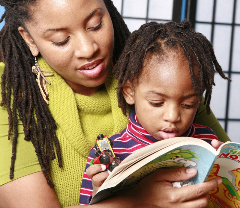 Image of African American woman and little girl reading