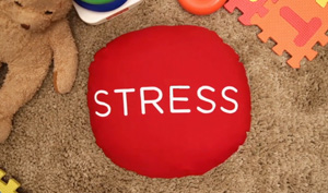 Image of a the word STRESS on a red circular pillow