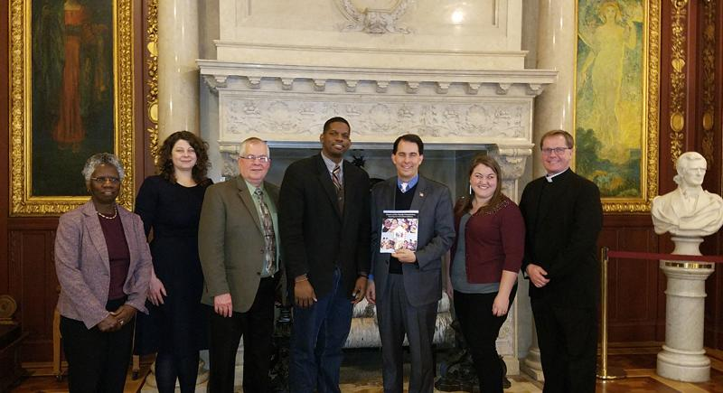 members of the Future of the Family Commission present report to Governor Walker