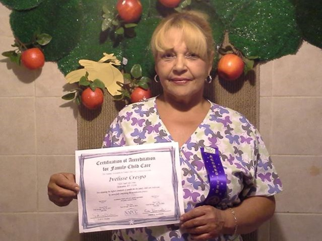 Child care provider Ivelisse Crespo with certificate